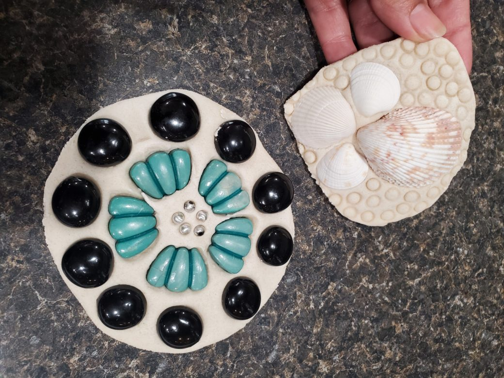 Two mosaic ceramic sculptures, decorated with seashells and other objects