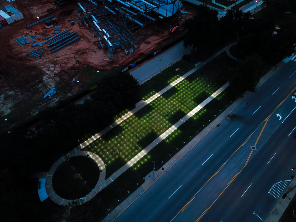 Arial view of Campbell Art Park lit up by a grid of small lights