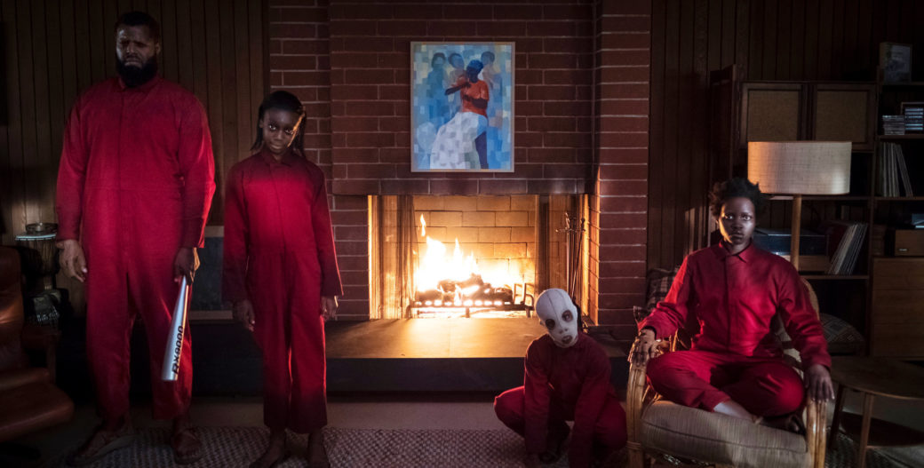 A still image from a horror film depicts menacing figures in red jumpsuits