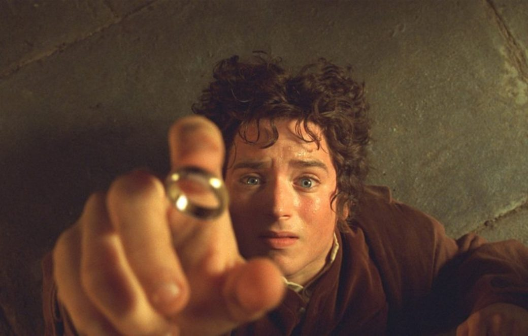 An image from the film The Lord of the Rings depicts actor Elijah Wood grasping for the golden ring