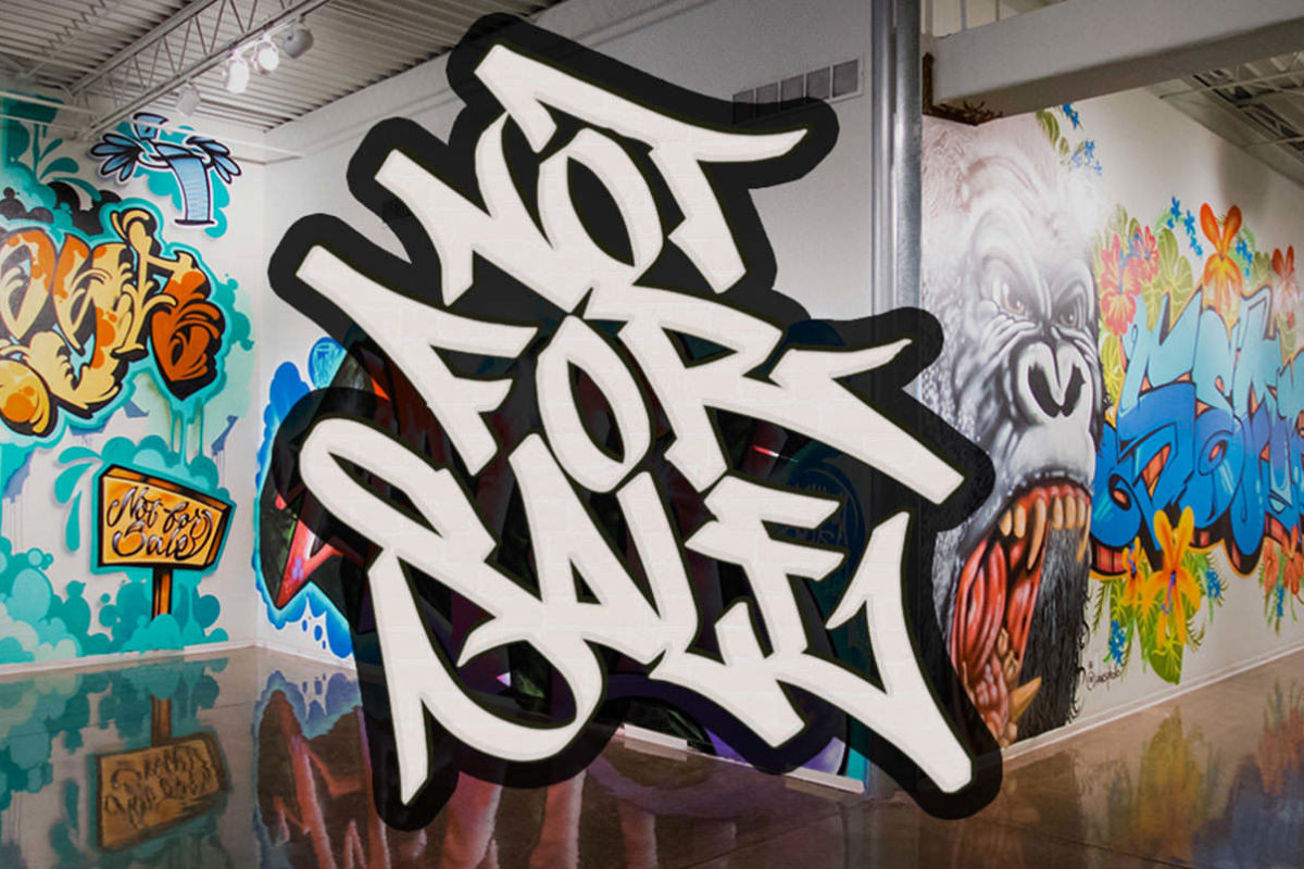 "White gallery walls covered in brightly colored graffiti with ""Not For Sale"" logo overlayed"