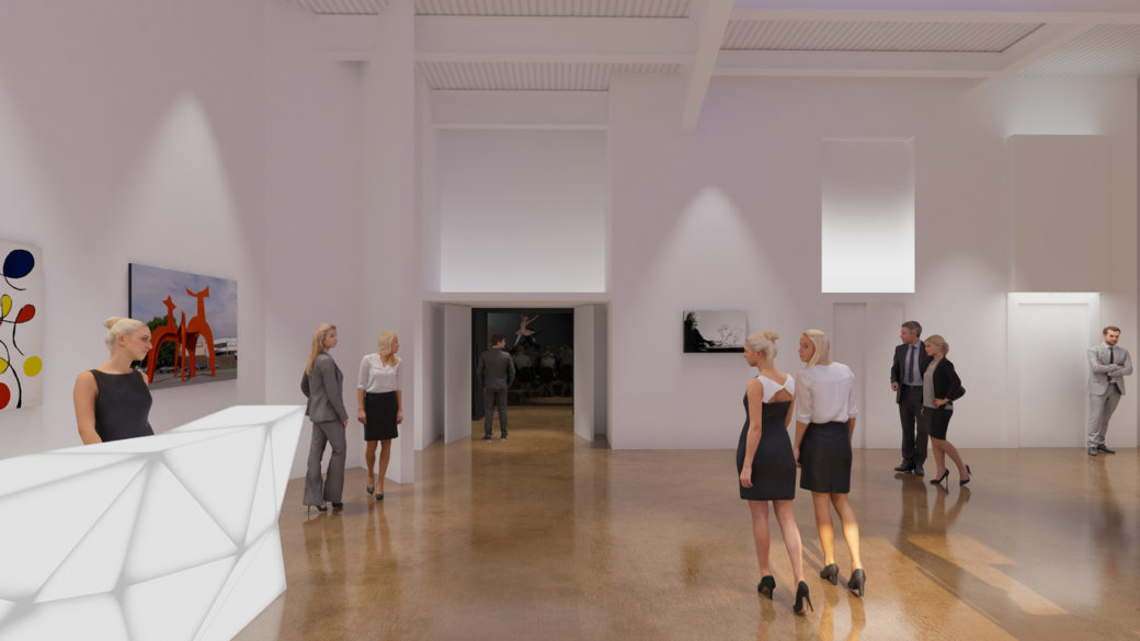 People walk through a white-walled lobby with art hanging up
