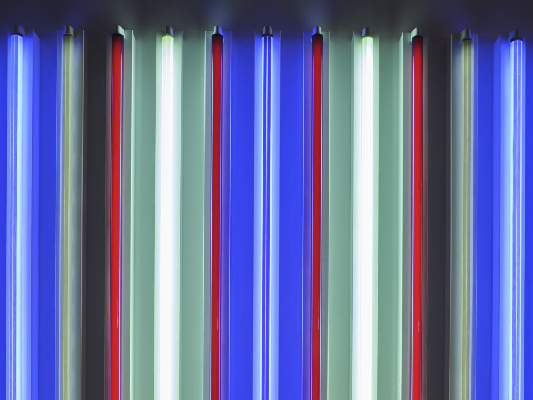A close-up detail photo of multi-colored fluorescent tubes of light