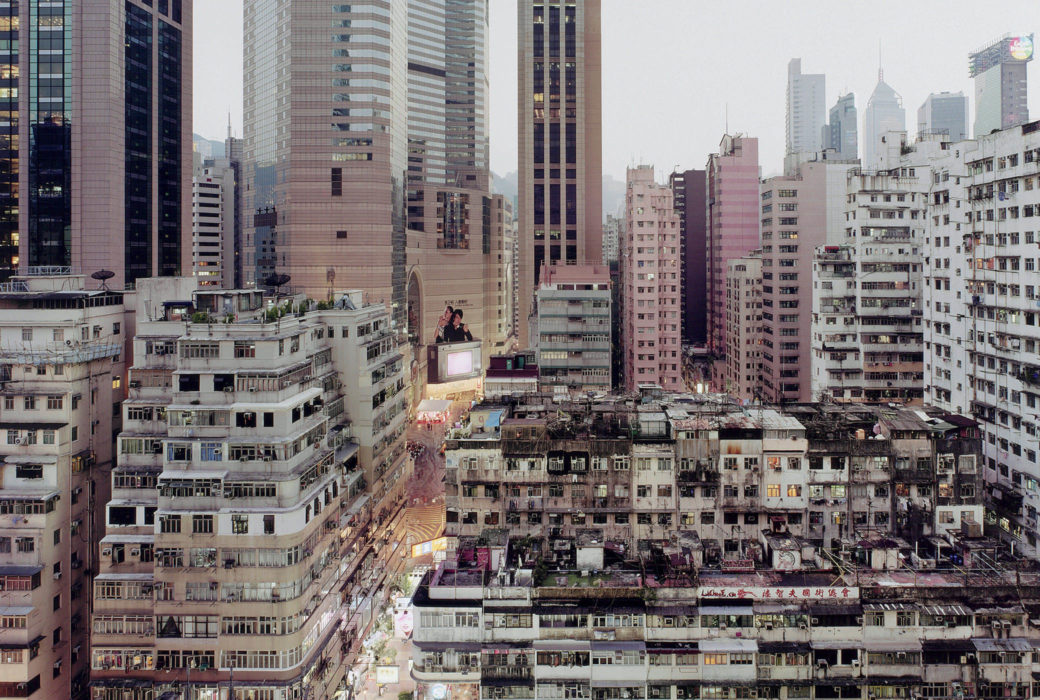 A photo of large, crowded buildings in busy downtown of a city