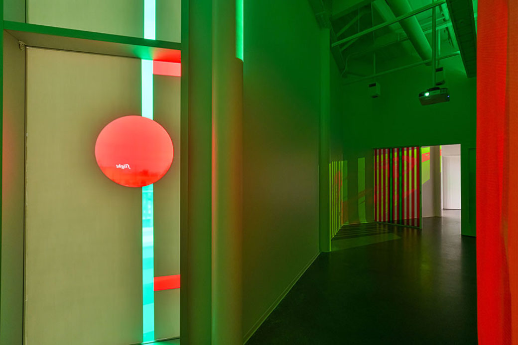 Installations and projections in red and green