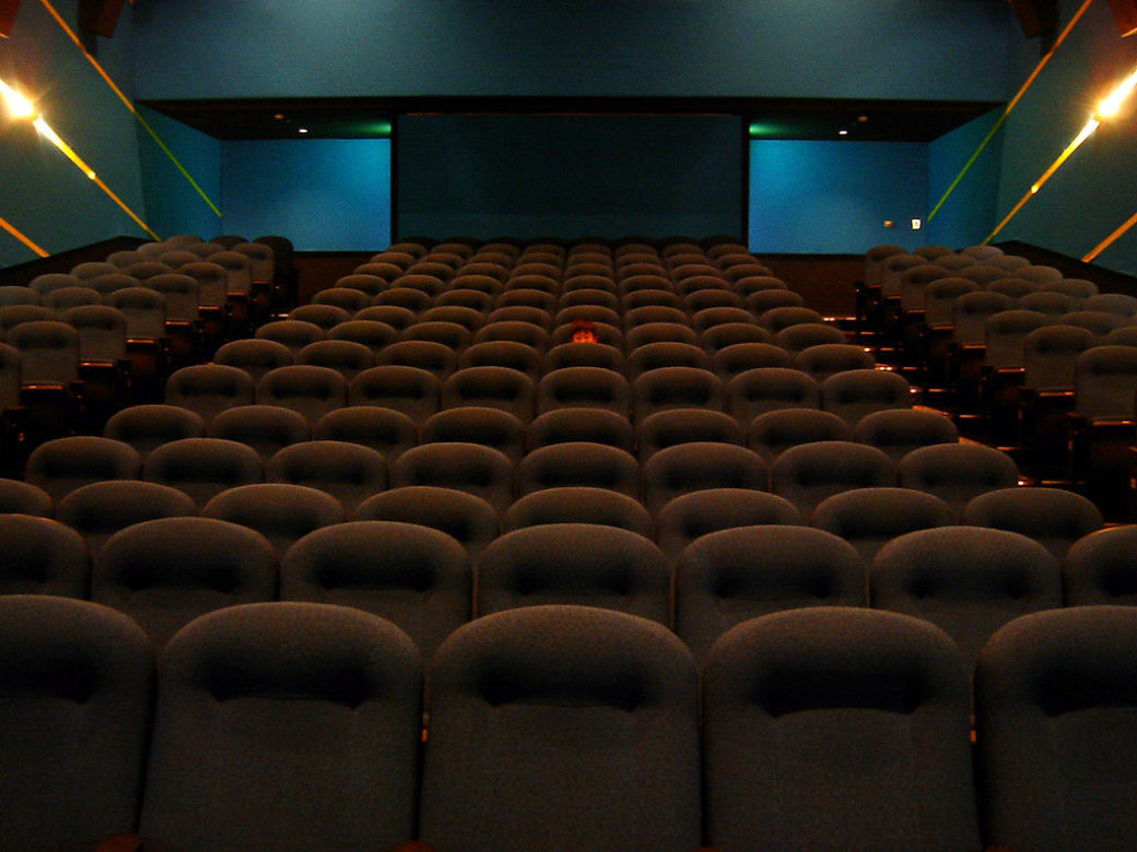 A movie theater with one attendee.
