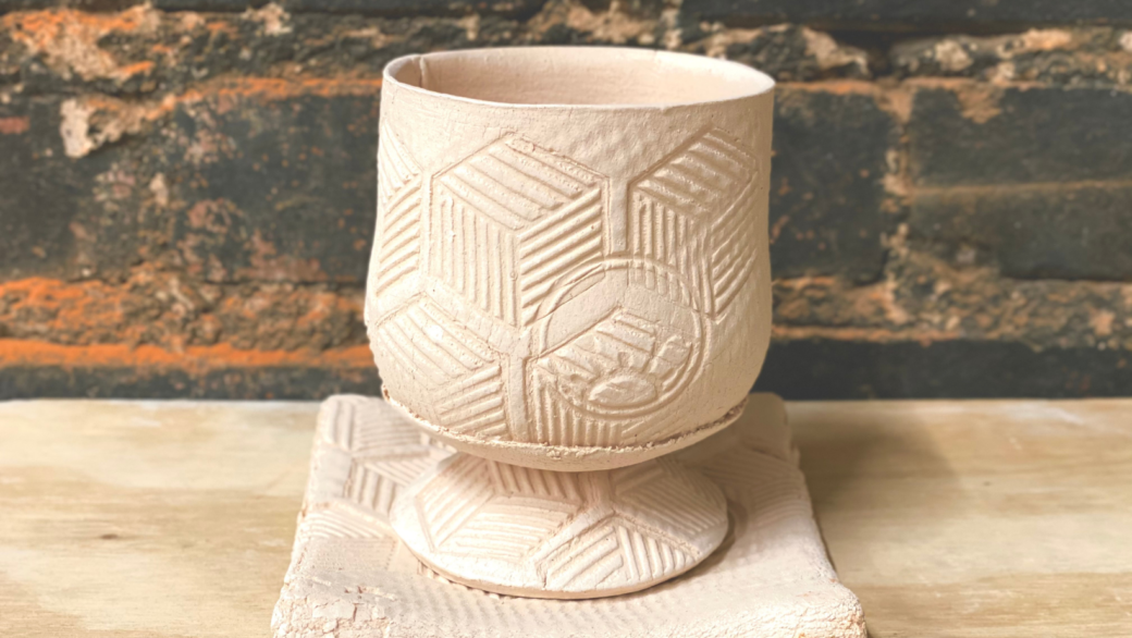 Unglazed ceramic cup and small plate