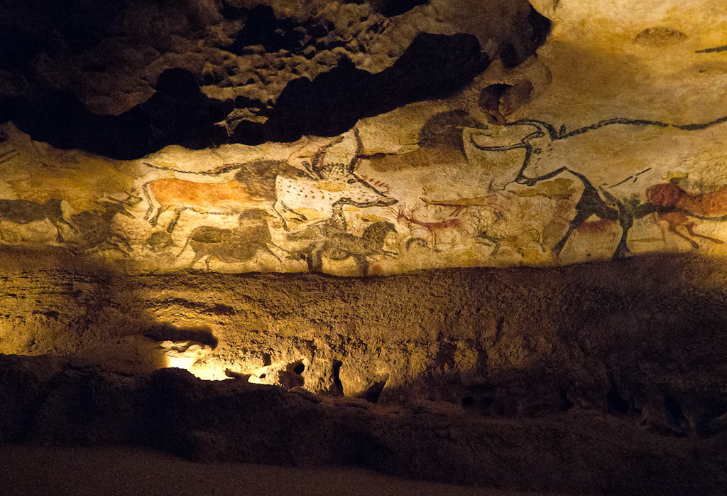 Paintings of horses, deer and bulls on a cave wall