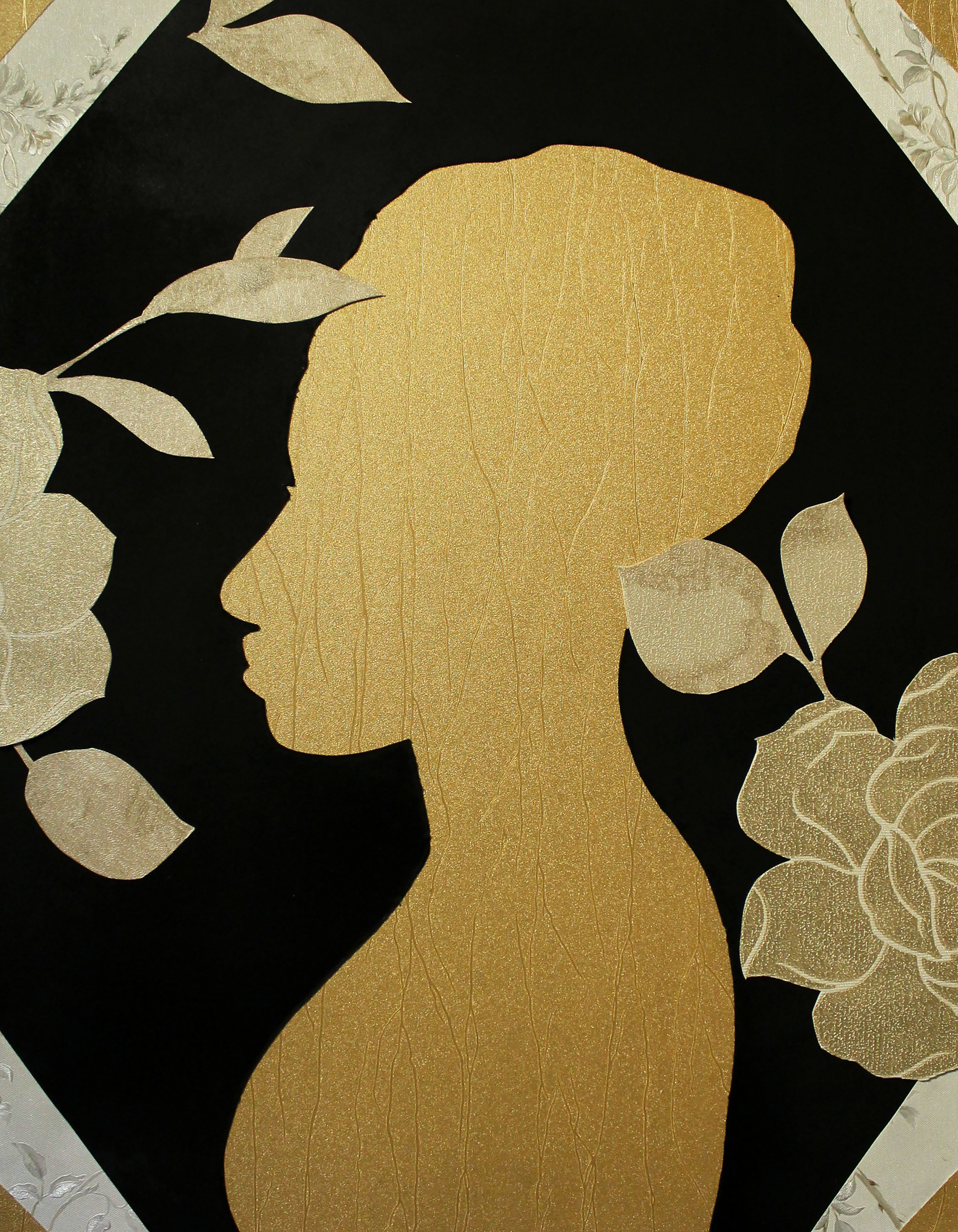 A gold silhouette of a woman surrounded by flowers