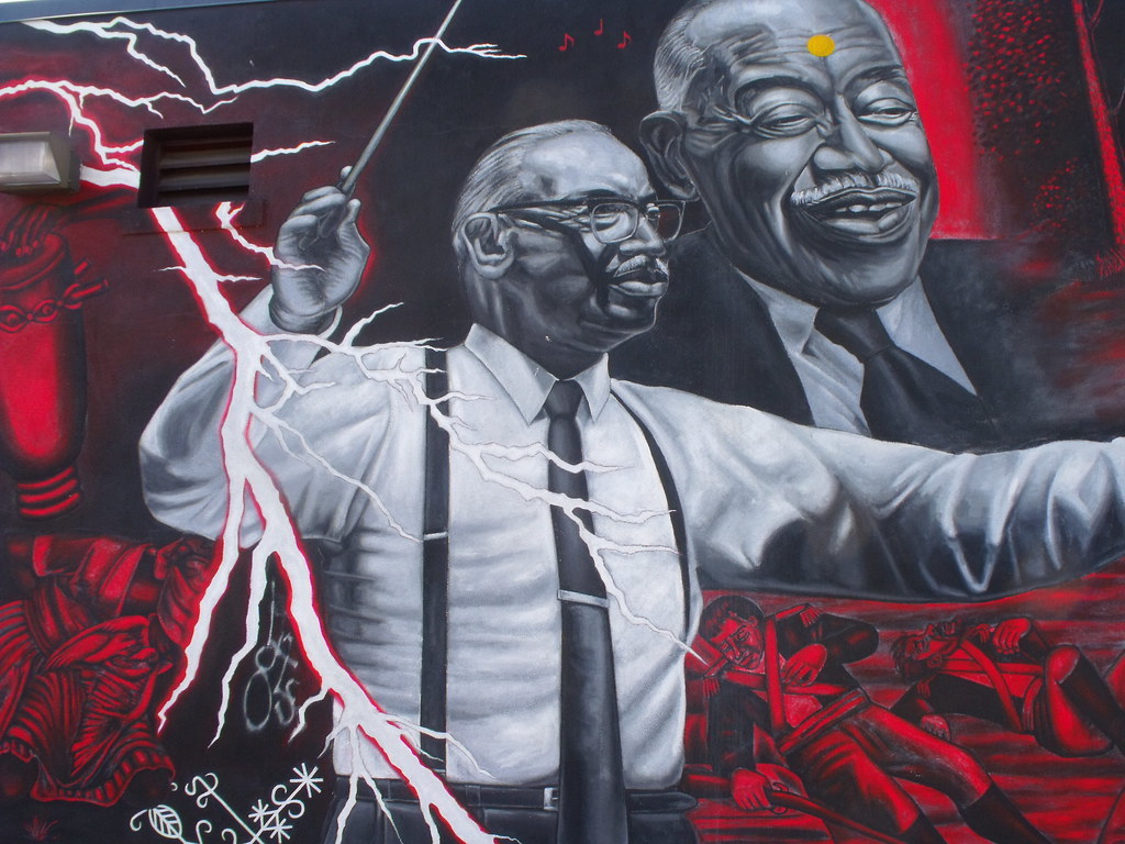 A mural of a composer conducting an orchestra