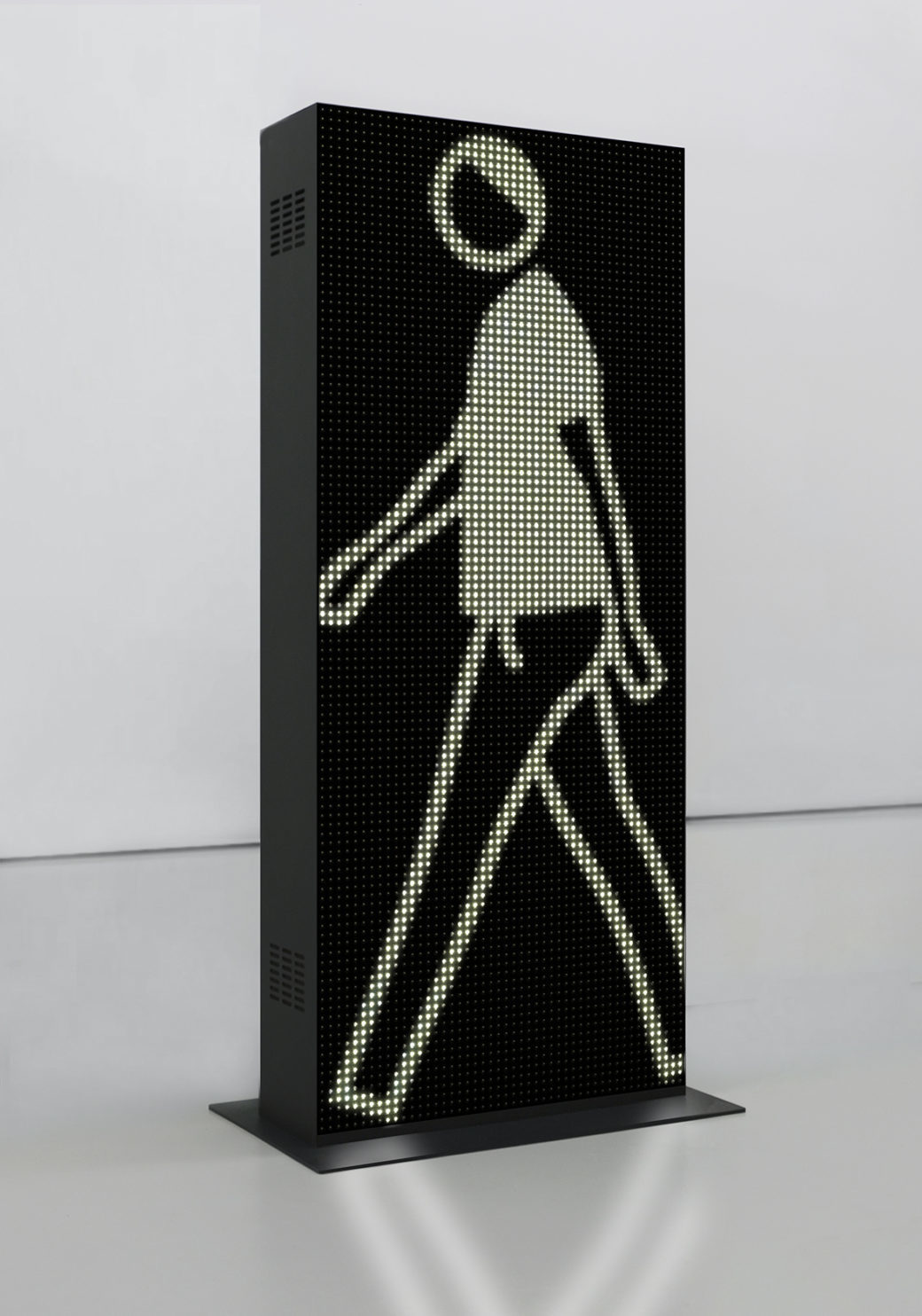 An LED sculpture depicts a walking figure