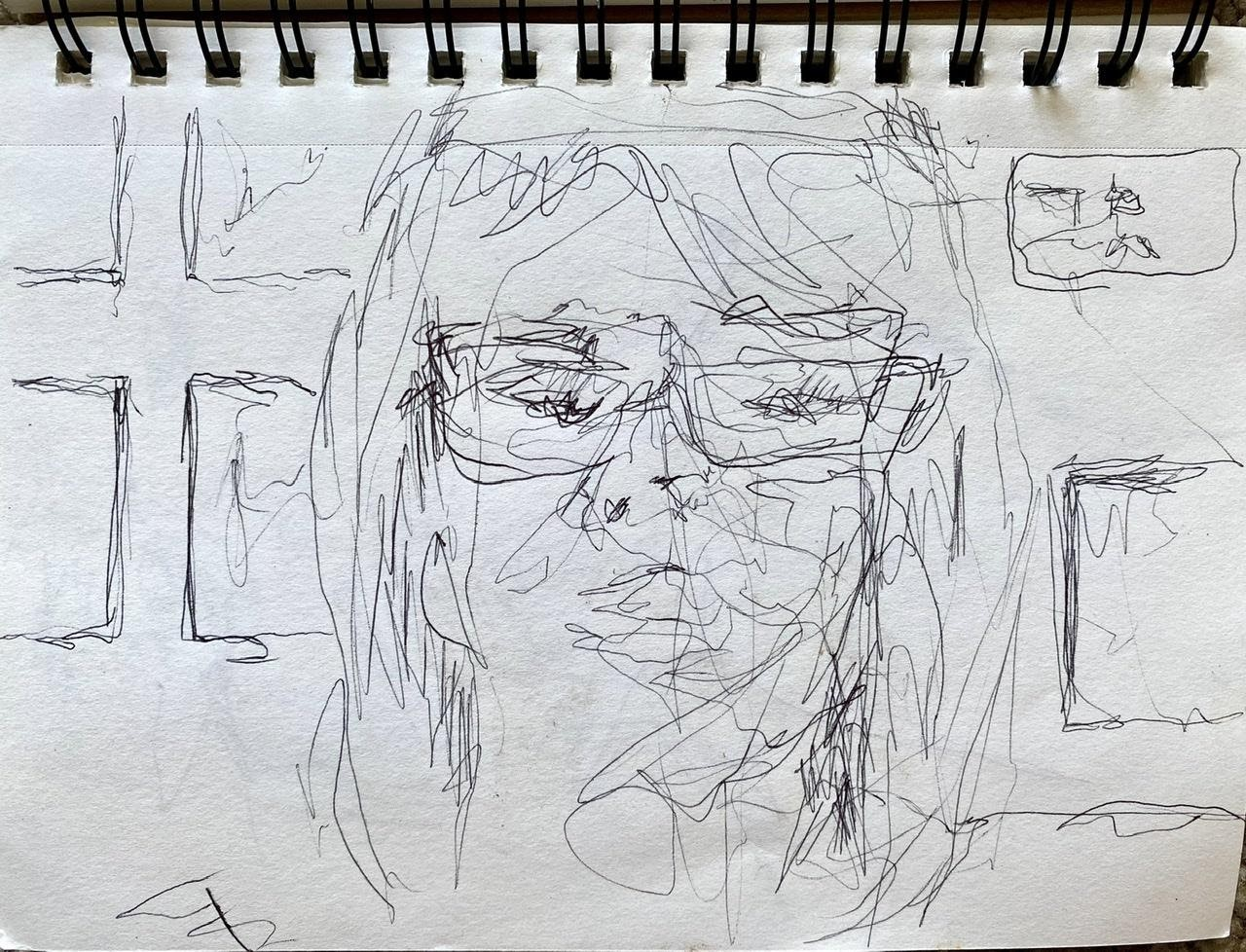 A rough sketch of a person with long hair and glasses