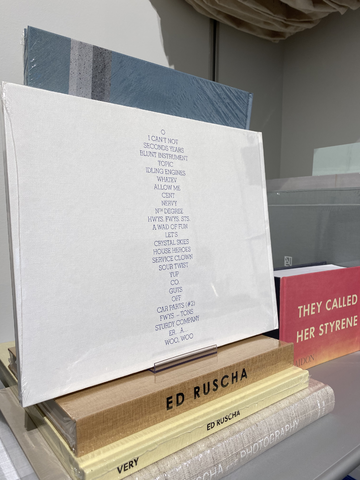 A display of books with the name Ed Ruscha on the spines