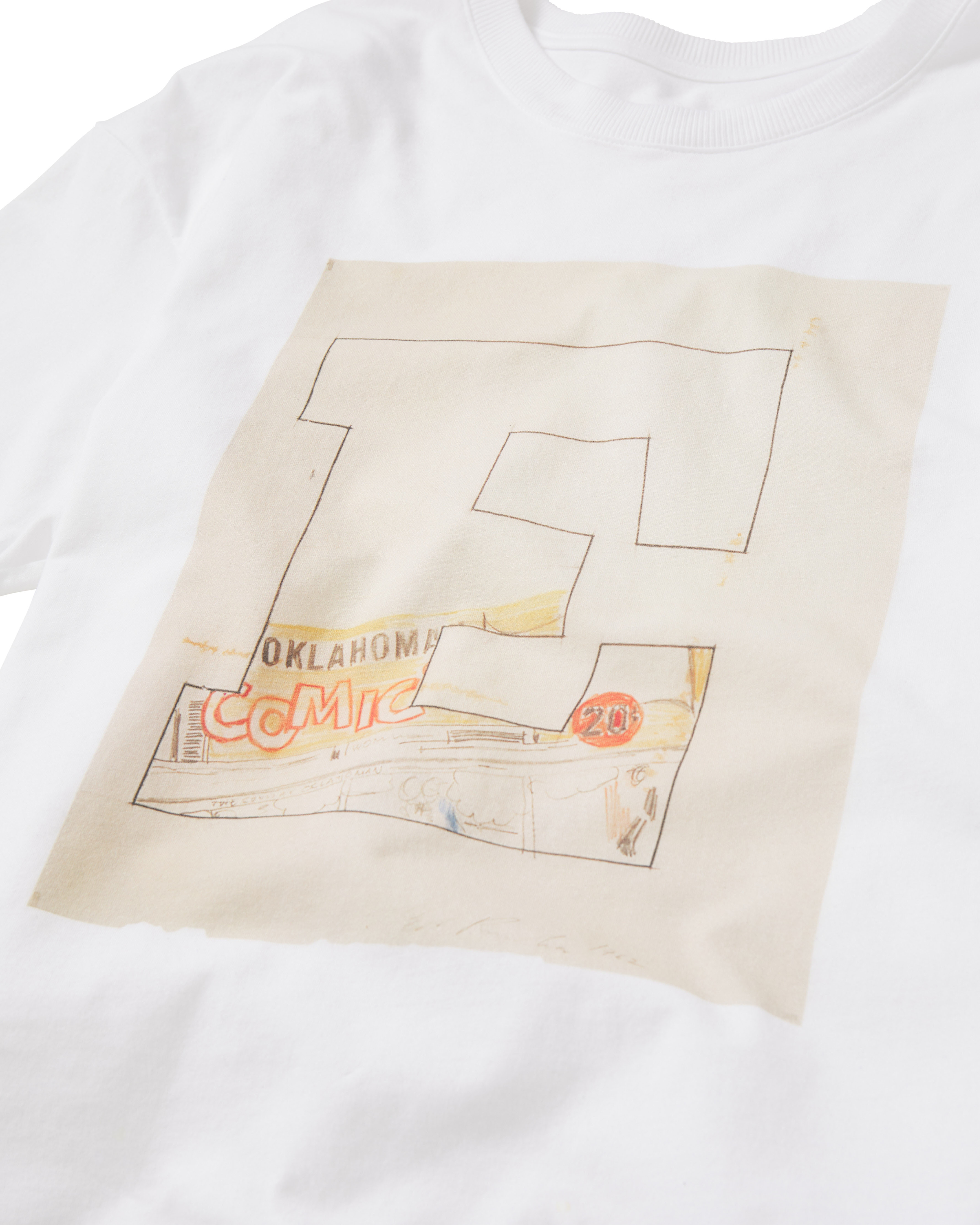 Cropped photo focusing on the primary design of a white T-shirt emblazoned with a large letter E