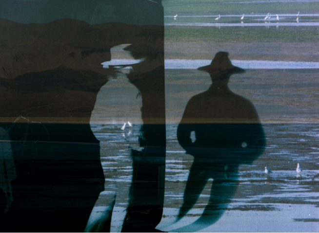 Contrasting projections depict two figures -- one light and one dark -- wearing wide-brimmed hats with no other identifiable features