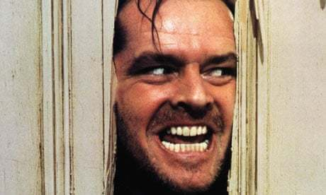 A still from the film The Shining depicts actor Jack Nicholson sticking his head through an opening in a door and smiling maniacally