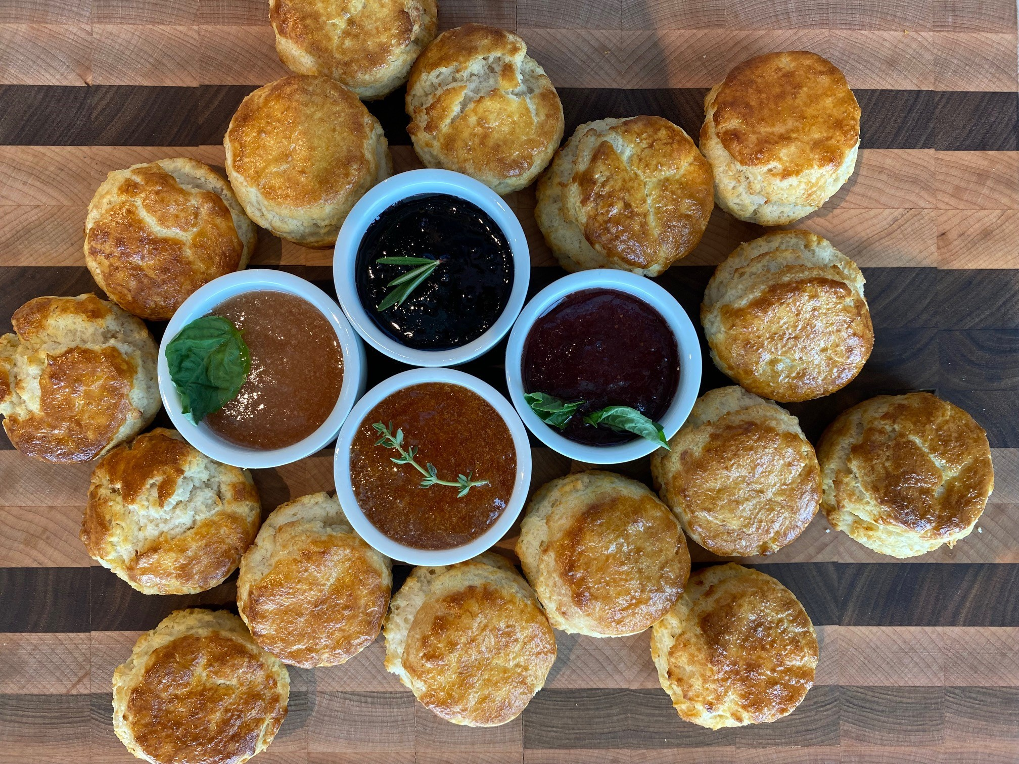 A tray filled with biscuits and jams
