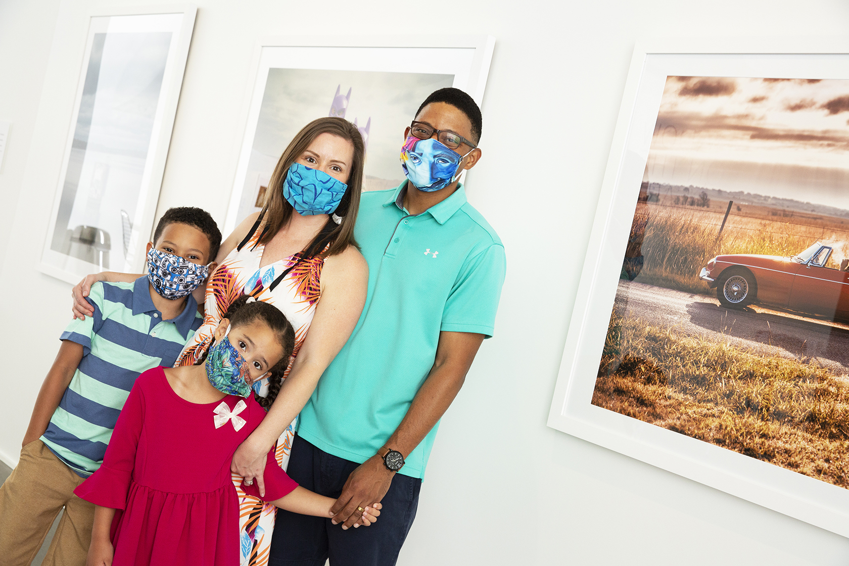A masked family poses in a gallery of photographs