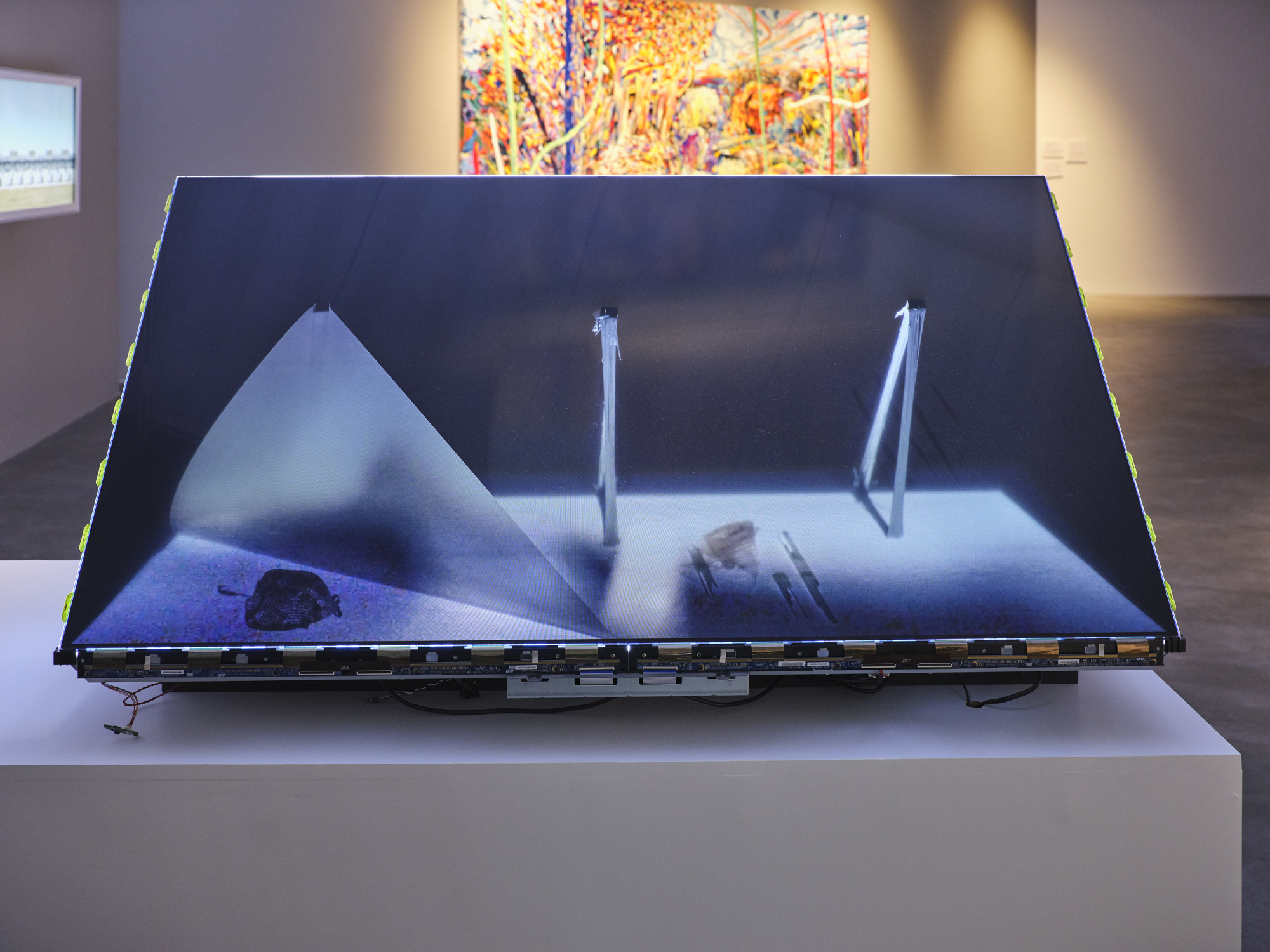 A photograph of an abstract art installation made from a deconstructed TV set