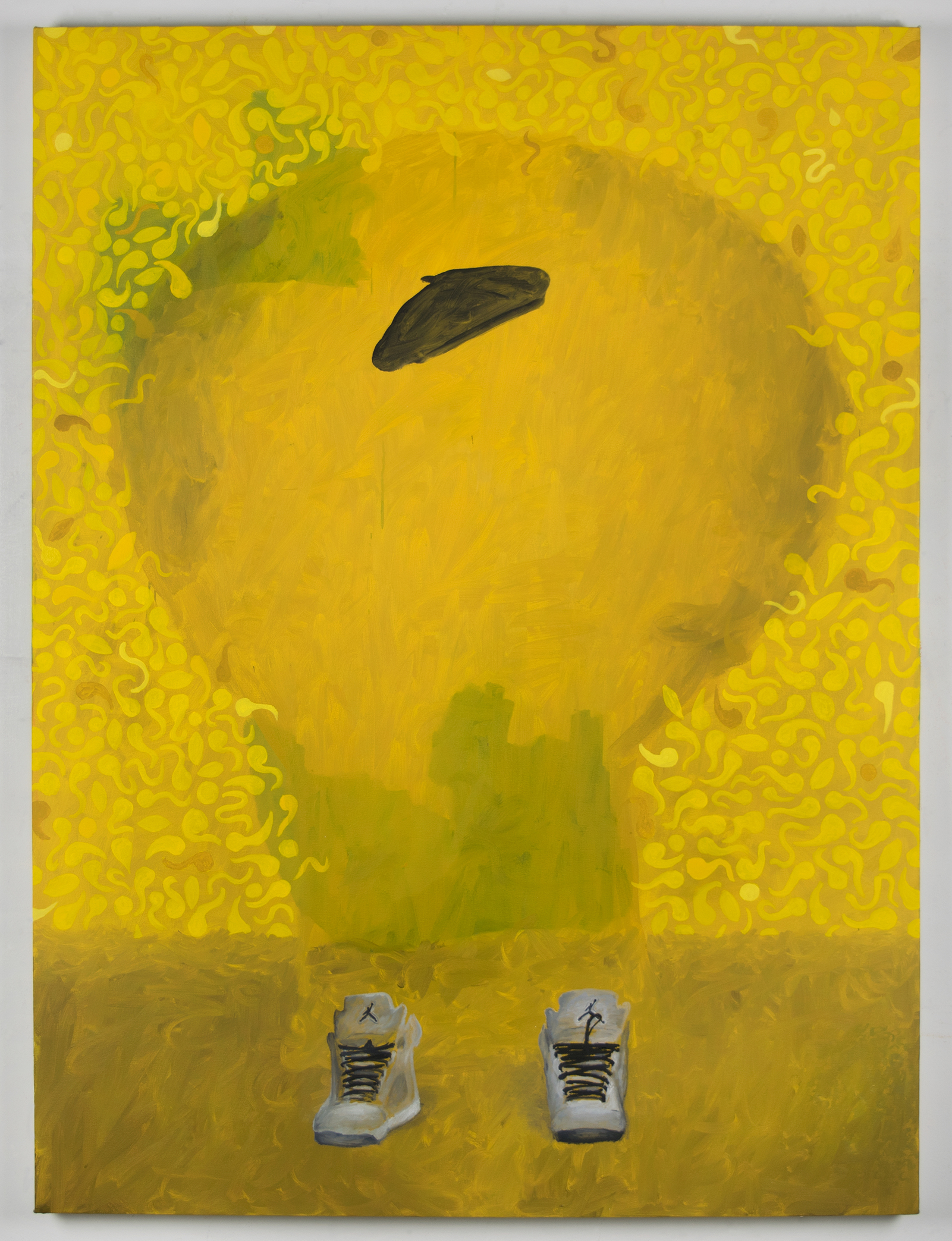 A yellow painting with various textures and two white tennis shoes