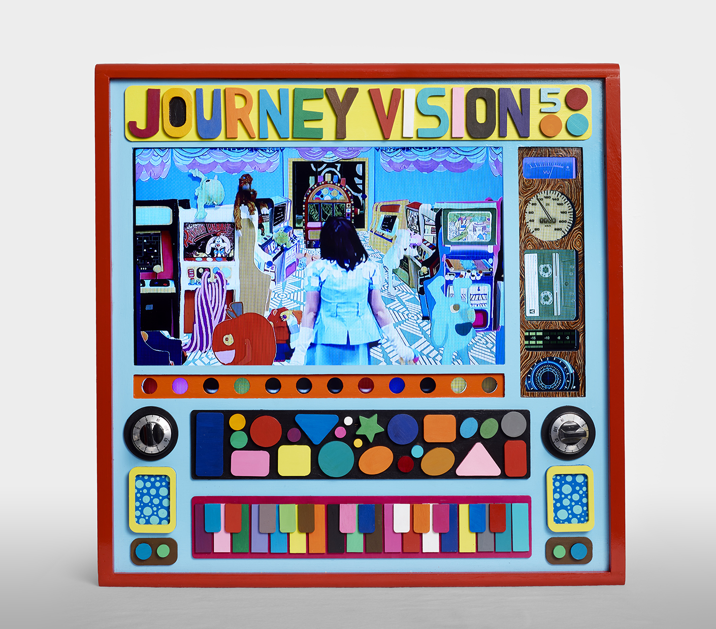 An artwork featuring a digital screen emulating a televsion set, decorated with dials and brightly color shapes reading JOURNEY VISION 5 across the top.