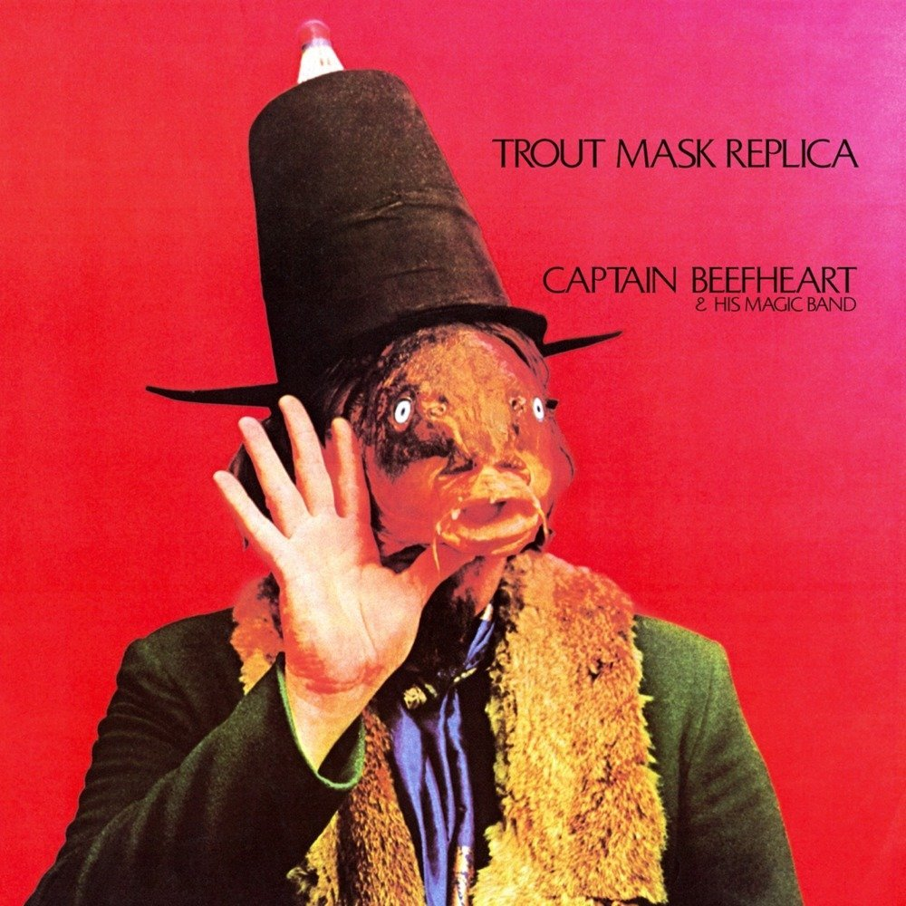 "Album artwork for ""Trout Mask Replica"" by Captain Beefheart, depicting a surreal image of a humanoid with a fish face and top hat"