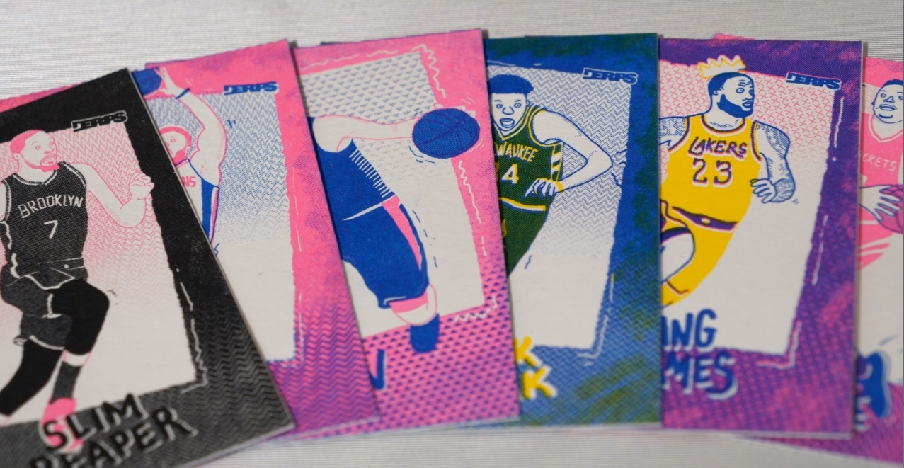A colorful display of artistic basketball cards, featuring players depicted in bright neon colors