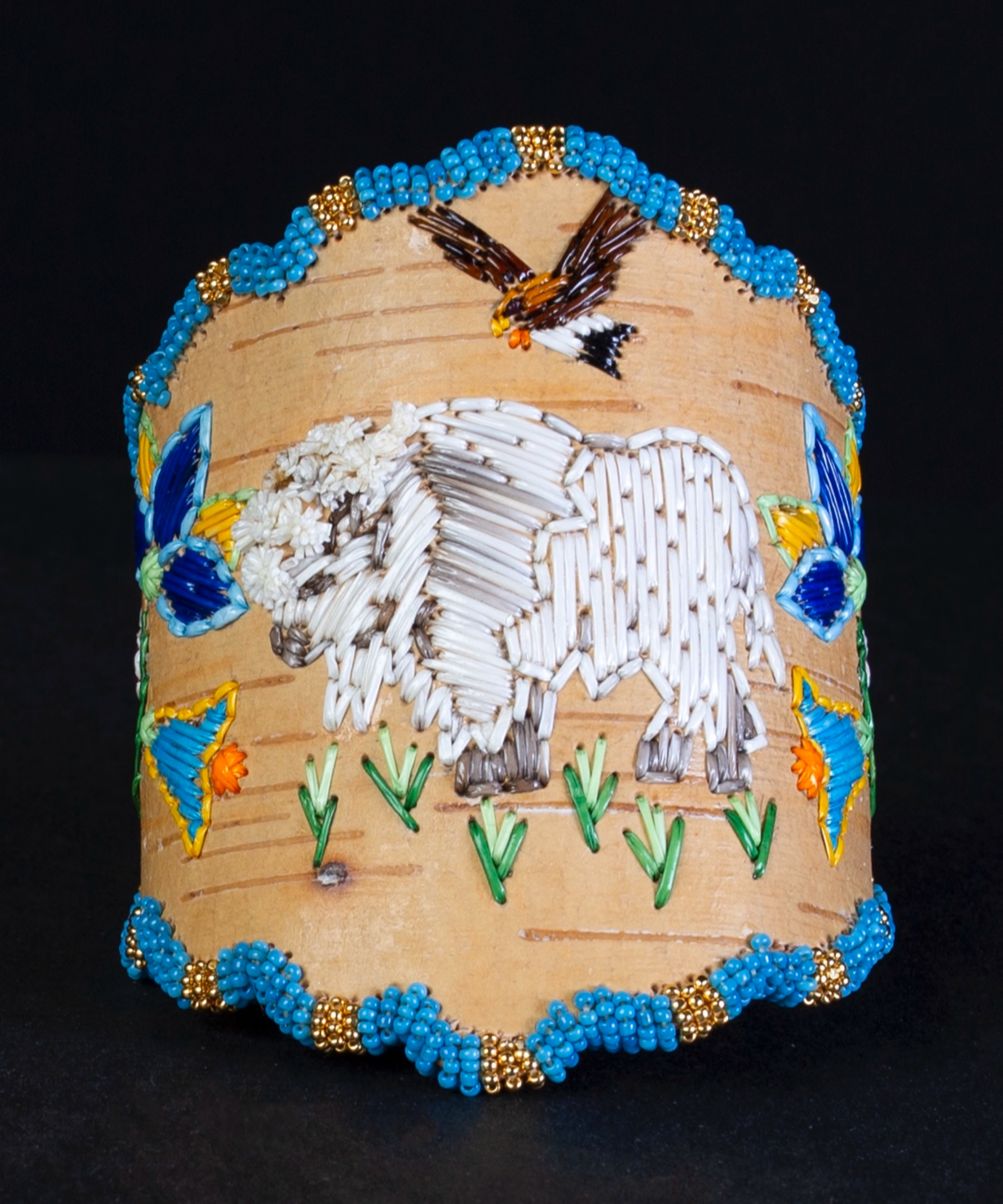 A piece of traditional Native quillwork depicts a white buffalo and eagle