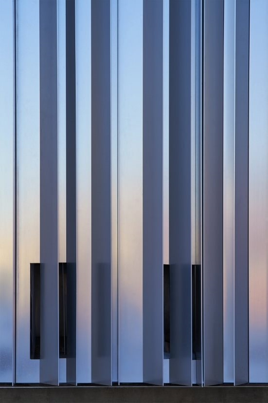 A close-up view of an aluminum facade on a silver building building