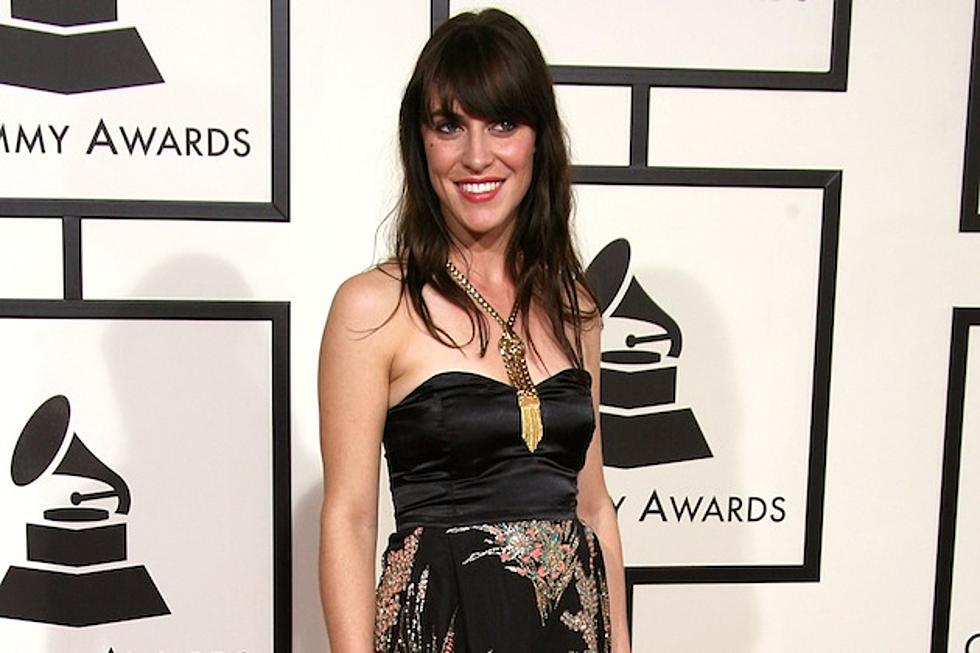 A figure in an evening dress is photographed at the Grammy Awards